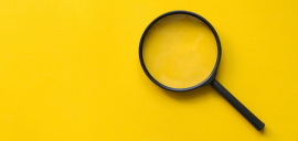 magnifying glass on a yellow background